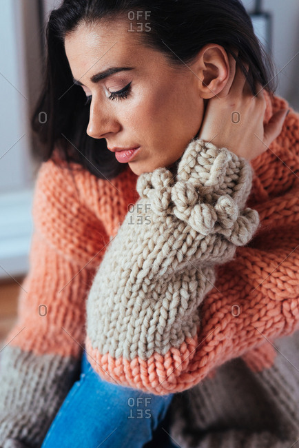 Woman in hand knitted wool sweater