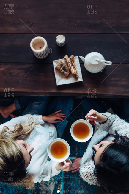 Aerial shot of two women drinking tea