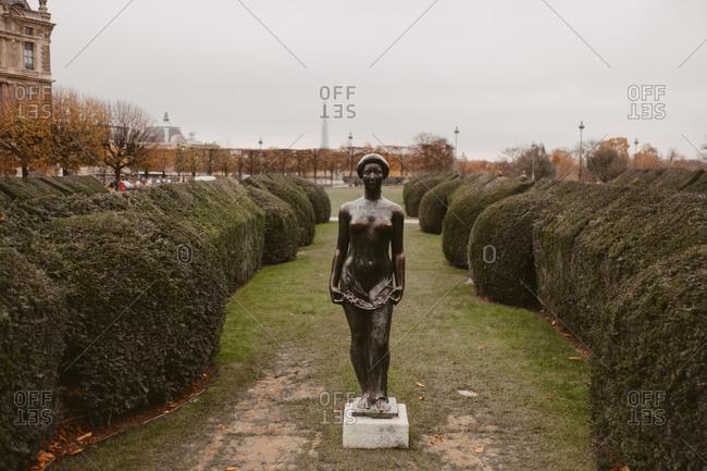 Paris, France - November 20, 2017: Sculpture between hedges at the Tuileries Garden