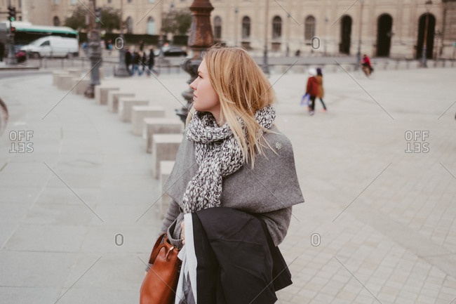Woman standing in a square, Paris