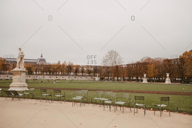 Empty chairs in park, Paris