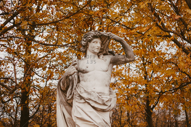 Sculpture in Tuileries garden with fall leaves in background