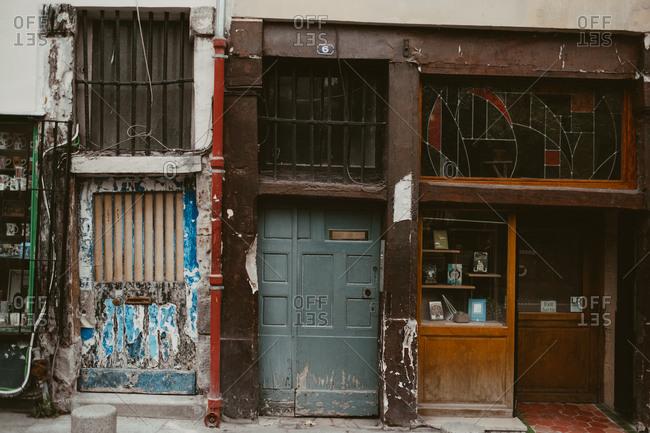 Paris, France - November 20, 2017: Details of worn down storefronts