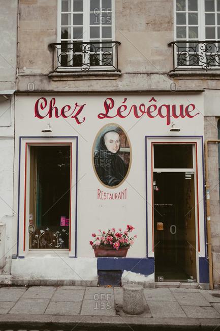 Paris, France - November 20, 2017: Hand painted sign for Chez Leveque restaurant