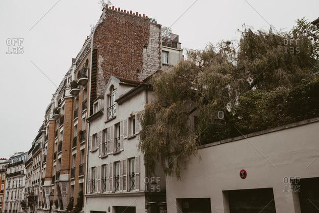 Paris, France - November 21, 2017: Rooftop garden and brick buildings