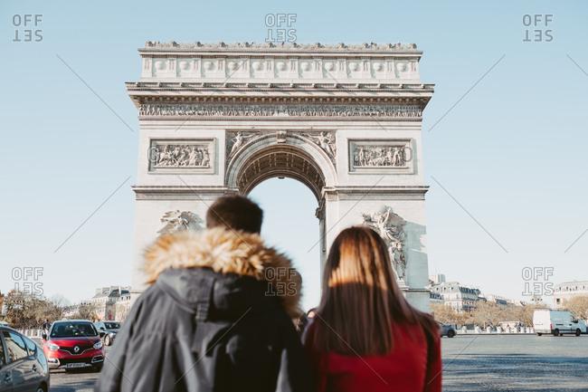 Paris, France - November 22, 2017: Couple looking at Arc de Triomphe