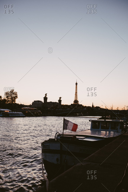 Paris, France - November 22, 2017: Silhouette of the Eiffel Tower at sunset with the seine river in foreground