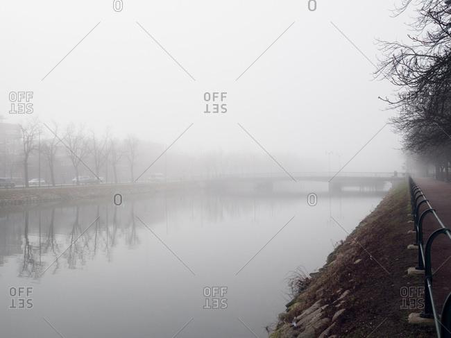 Looking across fog shrouded canal to far bank