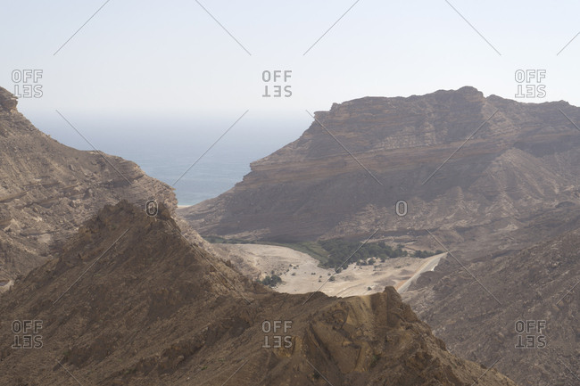 Wadi Sanaq, an oasis lagoon on the wild coast of Dhofar, Oman