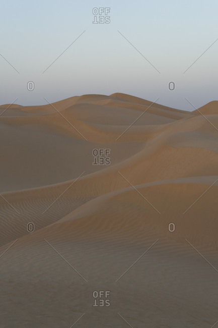 Desert dunes at sunset in the Empty Quarter, Oman