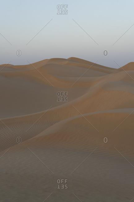 Desert dunes at sunset in the Empty Quarter, Oman