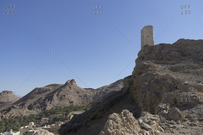 Dramatically situated old watchtower atop a hill south of Muscat, Oman
