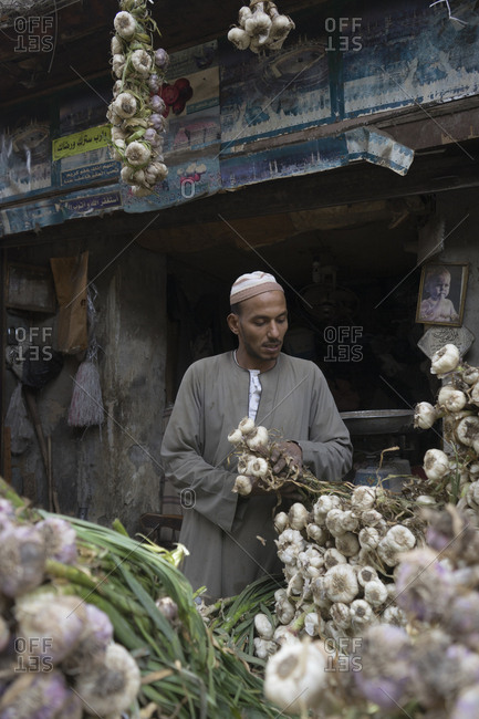 Cairo, Egypt - March 21, 2016: Garlic vendor in Islamic Cairo, Egypt