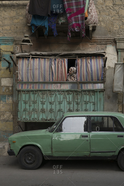 Cairo, Egypt - March 12, 2016: Woman in her home in the backstreets of Islamic Cairo, Egypt