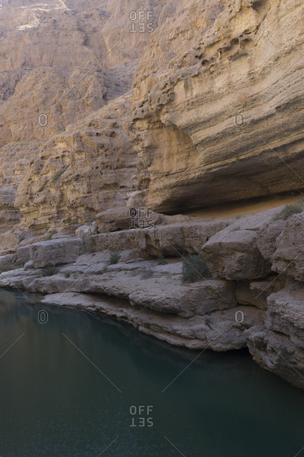 Narrow canyon of rock pools in Oman's Sharqiya region