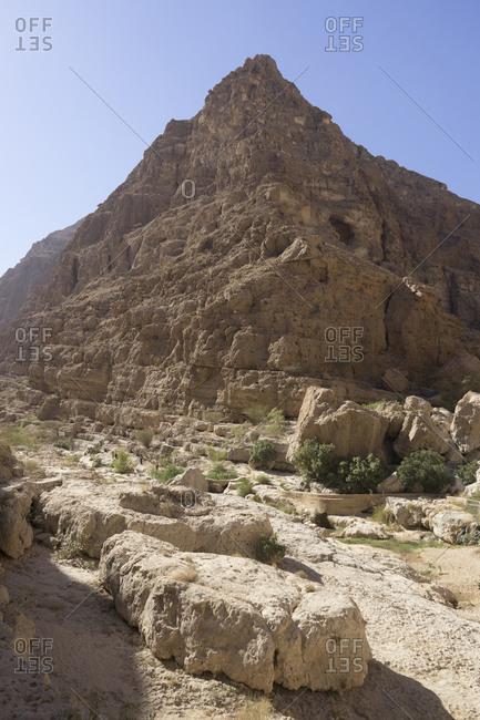 Scenic view of canyons and palm groves in Oman's Sharqiya region, Wadi Shab, Oman