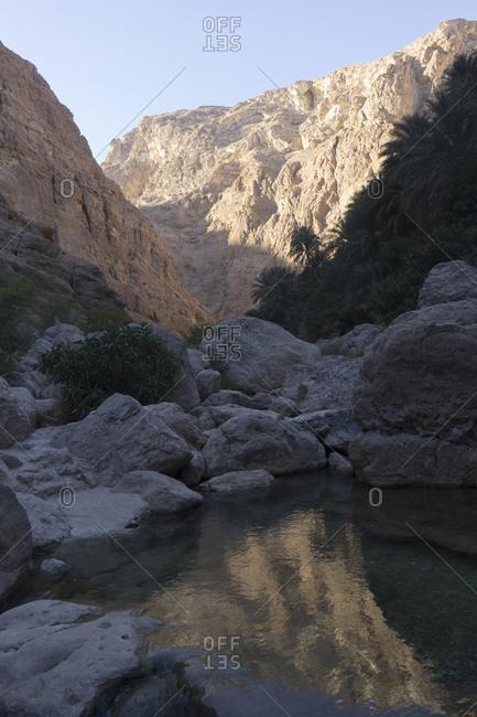 Canyon and rock pools at dawn in Oman's Sharqiya region
