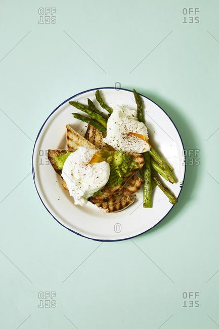 Eggs, avocado, asparagus on toast