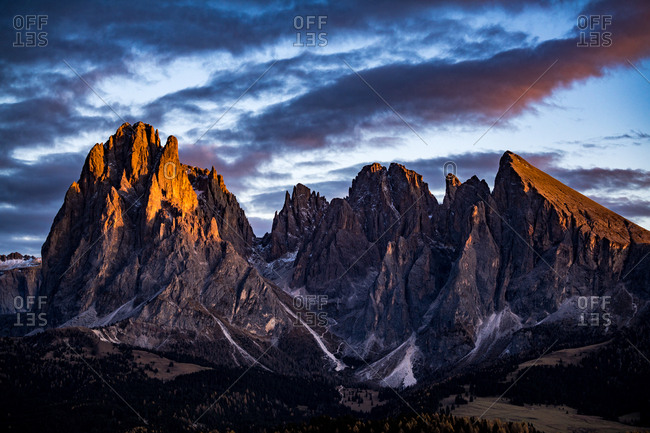 Italy, South Tyrol - November 1, 2017. Evening sun over the valley at the Alpe di Siusi with its rocky mountains.