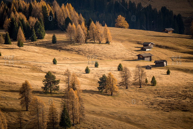 Italy, South Tyrol - November 1, 2017. Hiking paths and mountain cabins in the dry landscape of the Alpe di Siusi area of Southern Tyrol.