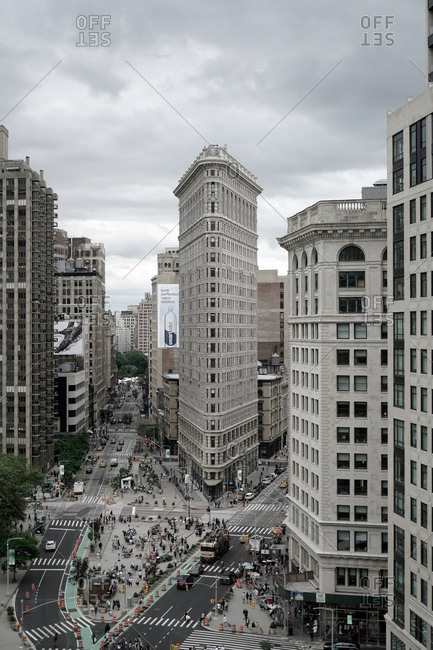 New York, United States of America - May 27, 2017: The view of the Flatiron Building also known as the Fuller Building. It is a triangular 22-story building in Manhattan and has been named as one of the world's most iconic skyscrapers and a quintessential symbol of New York City.