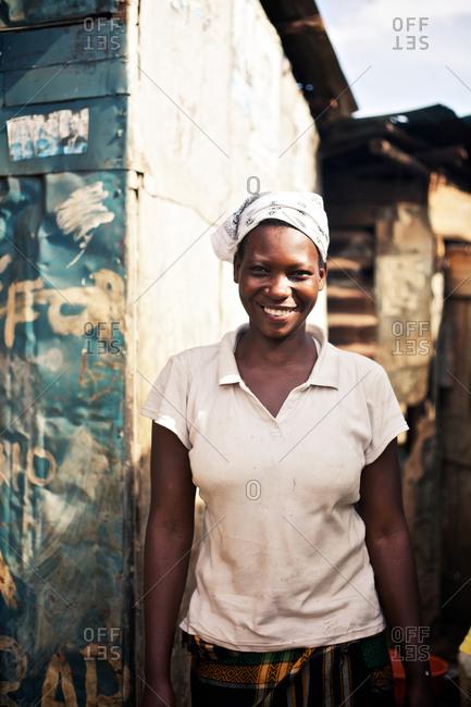 Kampala, Uganda - September 26, 2011: Smiling local woman in the Kamwookya neighborhood of Kampala. The Kamwookya neighborhood is known as a slum district and for low living standards.