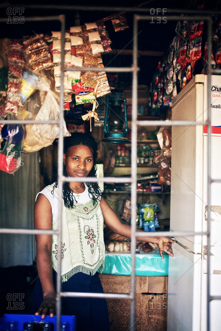 Kampala, Uganda - September 14, 2011: A woman looking out from the shop window in the Kamwookya neighborhood of Kampala. The Kamwookya neighborhood is known as a slum district and for low living standards.