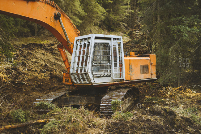 Excavator sitting on new road in forest
