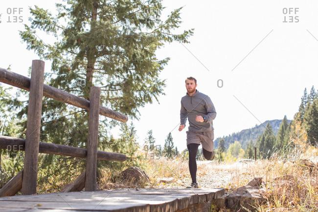 Man running through wilderness