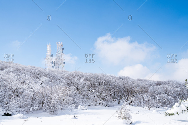 Snowy landscape with radio towers