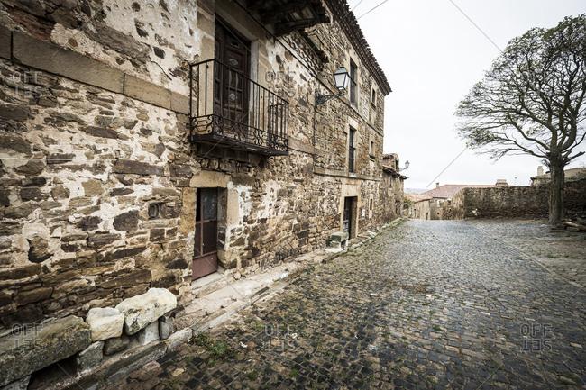 View of traditional stone buildings in the town of Castilfrio de la Sierra, Spain