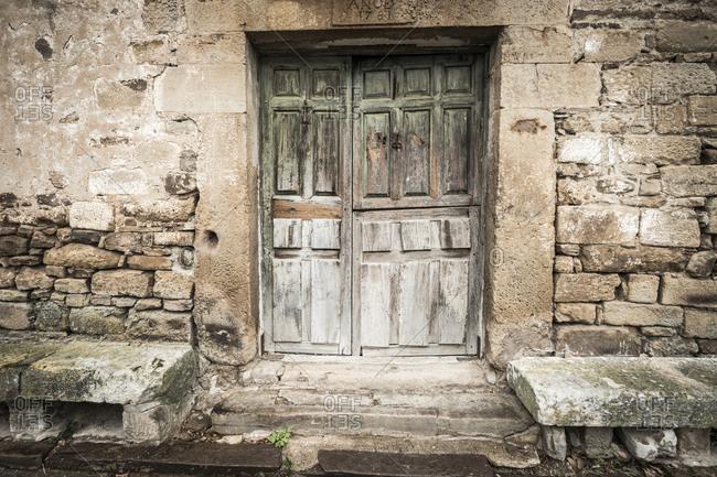 Doorway of a traditional stone building in the town of Castilfrio de la Sierra, Spain