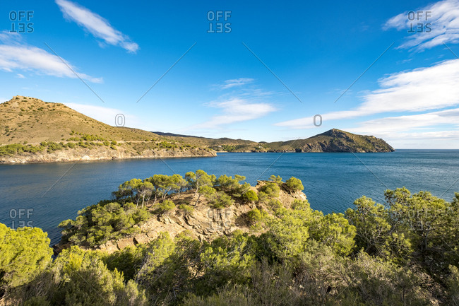 Looking across bay to barren coastline in the Cap de Creus natural park in Catalonia, Spain