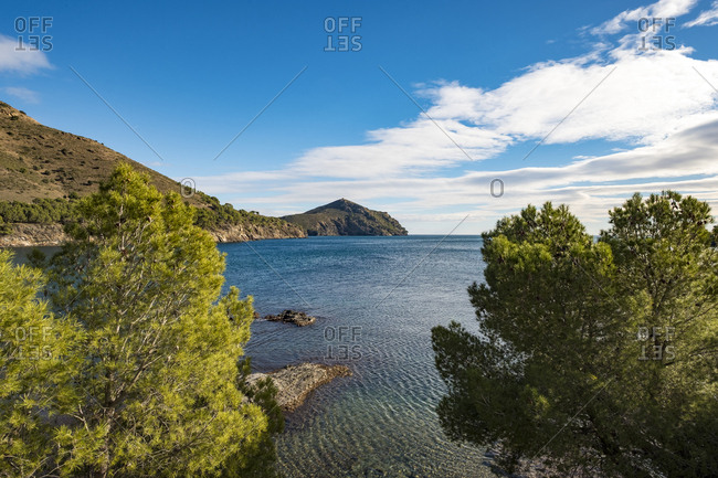 View across bay to rocky headland in the Cap de Creus natural park in Catalonia, Spain