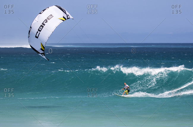 Indonesia - September 03, 2016: Australian Robert Kidnie kite surfing a wave in remote location