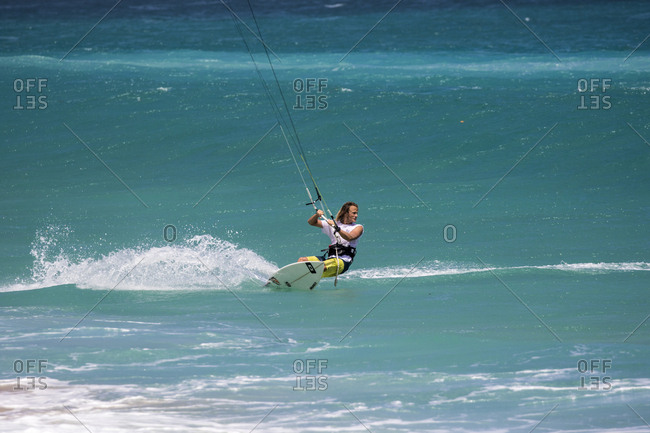 Indonesia - September 03, 2016: Australian Robert Kidnie looking for another wave while kite surfing in remote location