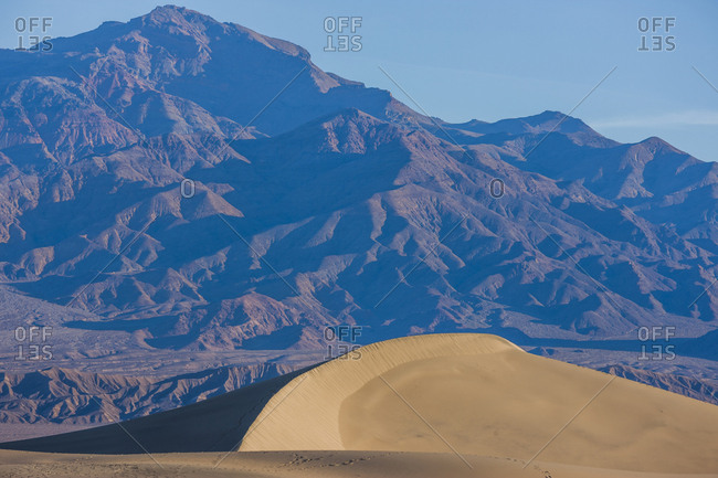Sand dune near mountain landscape