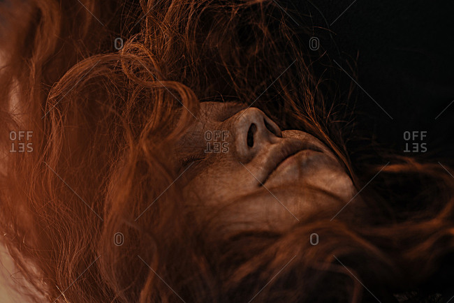 Wind blowing red hair of Caucasian woman