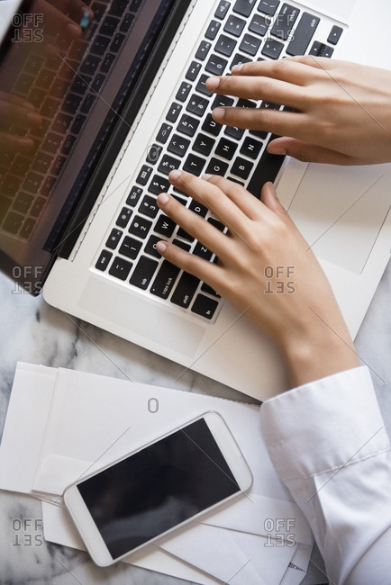 Hands of African American woman typing on laptop