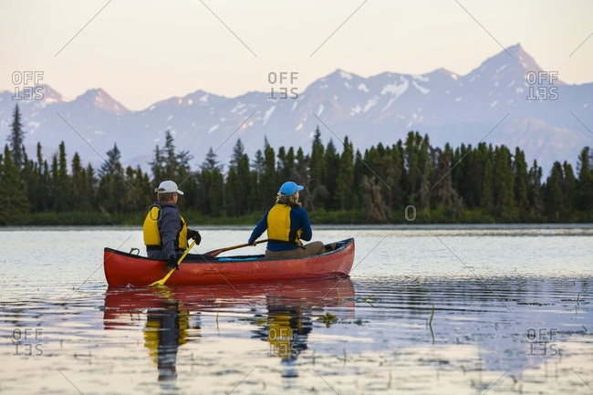A Couple Canoeing On Stone Step Lake; Homer, Alaska, United States Of America