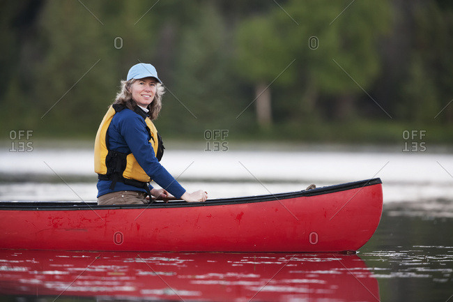 A Woman Canoeing On Stone Step Lake; Homer, Alaska, United States Of America