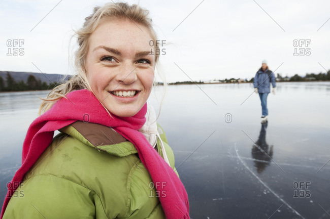 Ice Skating On A Frozen Lake; Alaska, United States Of America
