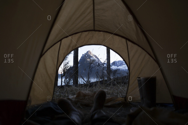 View From Inside A Tent Through The Door To The Rugged Peaks Of The Kenai Mountains, Kachemak Bay State Park; Alaska, United States Of America