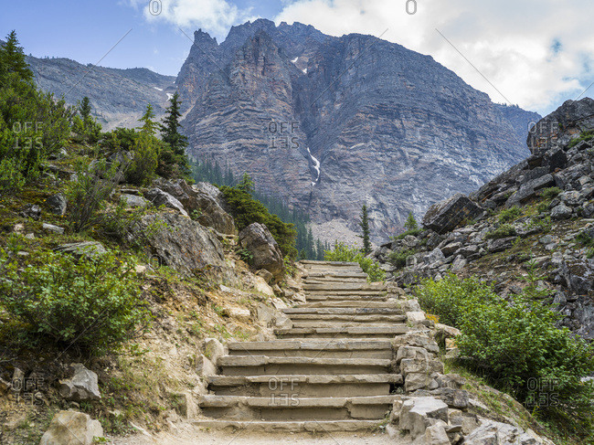 Steps leading up a towards a rugged mountain on a mountain trail in Banff National Park; Alberta, Canada