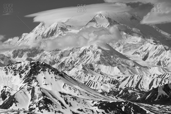 A 'cap cloud' covers the North and South Peak of Denali in early summer, viewed from Stony Dome in Denali National Park; Alaska, United States of America