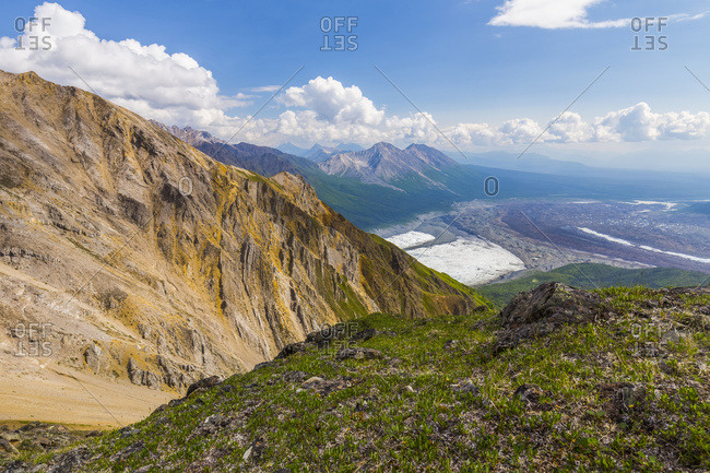 View of the intersection of Root Glacier (left) and Kennicott Glacier (right) from high on Donoho Peak in the backcountry of Wrangell-St. Elias National Park; Alaska, United States of America