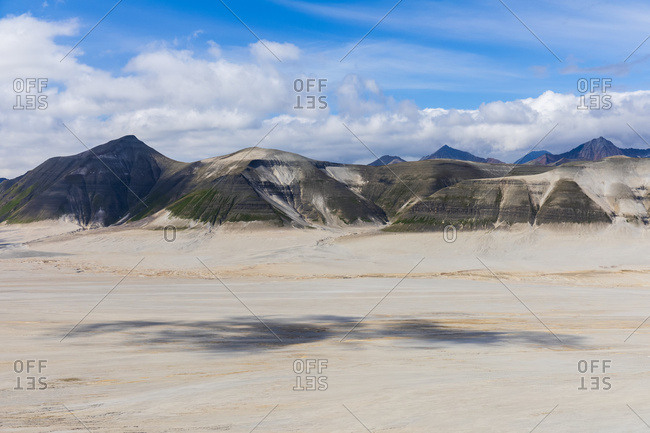 The Buttress Range borders the desolate landscape of the Valley of Ten Thousand Smokes in Katmai National Park; Alaska, United States of America