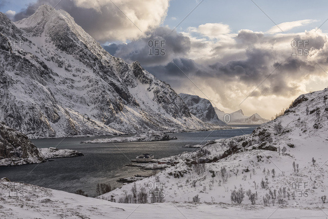 Rugged, snow-covered mountains along the coastline of Norway; Nordland, Norway