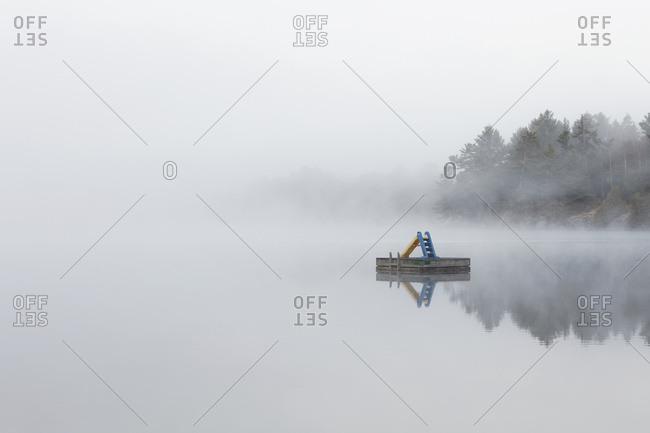 Fog shrouds a small island on Turtle Lake in Ontario�s Muskoka Region, near Rosseau; Ontario, Canada