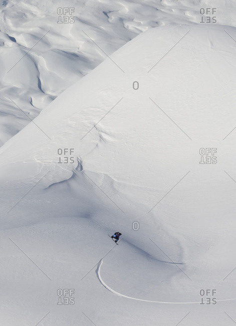 Snowboarding On A Snow Covered Slope; Haines, Alaska, United States Of America